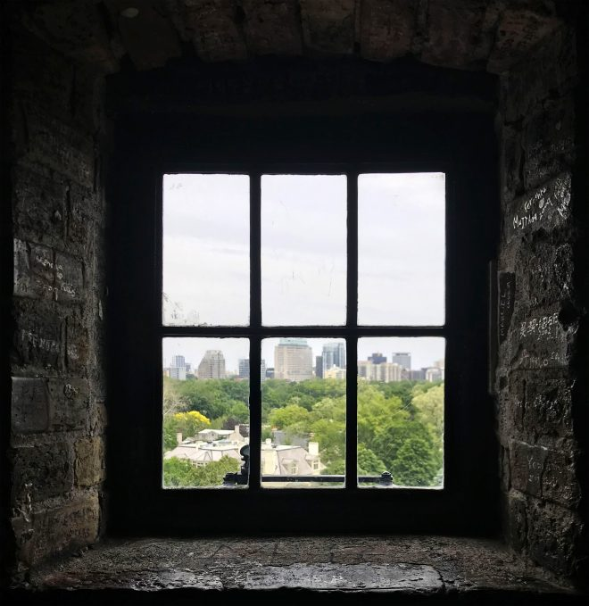 a window looking out to the city of Toronto